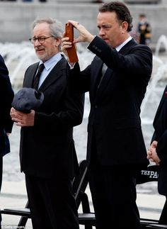 Firm friends: Hanks and Spielberg, seen at a World War II memorial ceremony in 2010, are c...