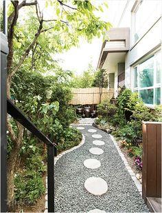 정원과 텃밭을 갖춘 세 아이를 위한 일층집 이미지 1