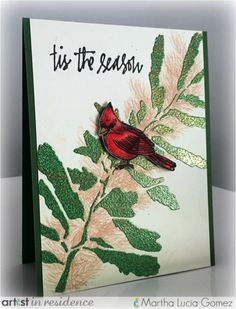 "Handmade greeting card featuring a cardinal on an embossed branch with the sentiment ""tis the Season"" by Martha Lucia Gomez. Kaleidacolor – Tomato Vine, VersaMark, Memento – Desert Sand and Tuxedo Black, Embossing Powder – Verdigris, Clear, Tear It! Tape, Fantastix"