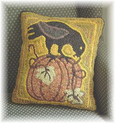 Primitive Folk Art Hooked Rug Hooking Paper Pattern Crow in a Pumpkin Patch by The Country Cupboard. $7.00, via Etsy.