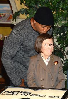 L.L. Cool J kisses actress Linda Hunt on the set of CBS' NCIS: Los Angeles while filming their 100th episode on Aug. 23, 2013.