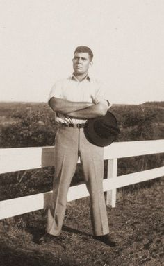 7/25/14 5:21a  Conan Sword & Sorcery Writer Robert E. Howard.  Another version  Outside holding his Hat and Standing by a Fence with  a Bold Stance rehconan.tumblr.com