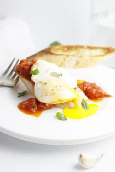 Eggs in Purgatory - Poached Eggs in Tomato Sauce www.bellalimento.com
