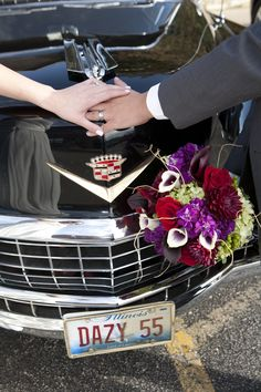 What a cute idea for newlyweds! Pose with your hands intertwined by the hood ornament of a Classic Wedding Car. Photo Credit: Studio one Photography- Naperville