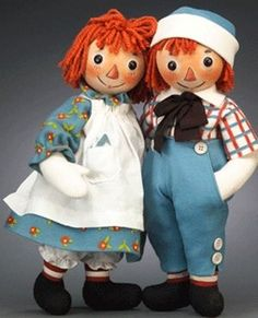 For Barbara) Raggedy Ann is 97 years old this year. Her brother Andy, is a some yrs younger. Marcella Gruelle, had faceless rag doll, so Dad John painted on big black eyes, a triangle shaped nose & wide grin. Mom Myrtle made her clothes of red, white & blue. Fam.Frnd James Witcomb Riley inspired the name. Dad a cartoonist made up adventures and how Raggedy got her heart, sewn into body. Marcella died as teenager and grieving Dad got stories published as tribute to her memory in 1918.