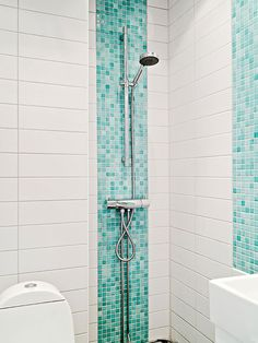 Love the panel of mosaic tiles. They're too much when used for a whole bathroom but this is perfect.