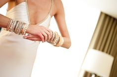 Love the exposed back dress here with all the bracelets.  So pretty, while still keeping a nice edge.
