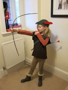 My daughter Addy's Robin hood costume for Book week. I found the pattern and instructions online to make the hat. I made a sachet to hold her arrows which my hubby made from Bamboo. He also made her bow from a branch and string.