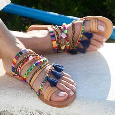 Handmade to order boho sandals Pax Slip on sandals with six straps and a toe ring embellished with friendship bracelets, ethnic trims, semi precious stones, beads, shells and tassels. Moroccan vibes and gypsy chic style. Pax sandals have it all. You need no extra accessories or jools and they can be worn in many different occasions day or night. Mega love !! Everything is handsewn onto the shoes. sizes available EU____.....35......36......37......38.......39.......40......41.......42…