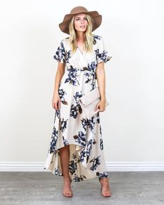 Spring vibes have arrived and our Blue Bonnet MaxiDress is perfection! A cream hued wrap dress with dark blue and brown florals. This soft and vintage inspire