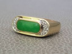 Check out this item in my Etsy shop https://www.etsy.com/listing/525742978/14k-jade-diamond-ring-saddle-ring-size-8