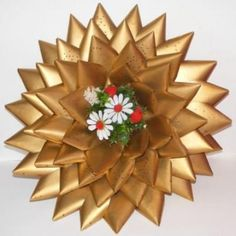 I can remember when my mom and sisters would make these for church Christmas Bazars back in the 1960's. They were made out of computer punch cards. My mom's always had poinsettias in the center.