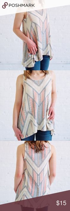 """Geo Tank Sweater-like material is lightweight and loose-fitting. Pair it with destructed denim shorts for a laid-back, boho inspired ensemble.  Fabric & Care: - 49% Polyester, 41% Rayon, 3% Spandex - Hand wash cold - Flat dry - Made in the U.S.A.  Sizing & Fit: - True to size - High-low hemline - Model is in a size small  Model is 5'3"""" tall   36"""" bust   27.5"""" waist   38"""" hips Tops Tank Tops"""