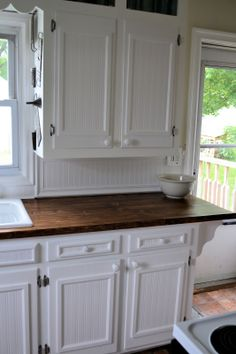 kitchens with stained wooden baseboards | We used chair rail and actual bead board for the backsplash.