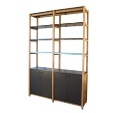 """Scout Regalia SR Bookcase 2 Bay I Remodelista...Above: The company takes orders by email and phone and offers a range of materials and finish choices for each design. For instance, the Gordon Wall Bracket, $700, is available with clear or """"seedy"""" glass and two versions of oxidized brass"""