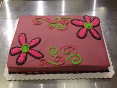 Multicolored flowers and scrolls cake