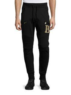 PIERRE BALMAIN Logo-Appliqued Jogger Pants. #pierrebalmain #cloth #pants