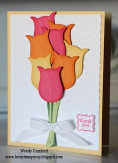 Punch Art Tulips using Owl punch. No instructions on website but looks like they have run an embossing tool along the cardstock to define the petals.