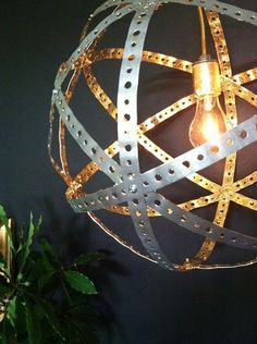 Great DIY industrial chic pendant light  Want to repurpose rusty old wine barrel bands to make this.