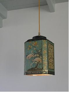 Tin Can Light This great idea comes from Hans Groenwold. Look up his work! The lights are made from vintage tins. Maybe it would just be easier to buy one of his impeccable made lights! Tin Can Lights, Diy Luminaire, Lampe Decoration, Thrift Store Crafts, Vintage Tins, Vintage Style, Lamp Shades, Solar Lights, Pendant Lamp