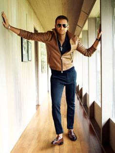 Pairing a brown leather bomber jacket and dark blue suit pants will create a powerful and confident silhouette. Choose a pair of brown leather loafers for a more relaxed aesthetic. Shop this look on Lookastic: https://lookastic.com/men/looks/bomber-jacket-polo-dress-pants/15580 — Dark Brown Sunglasses — Navy Polo — Brown Leather Bomber Jacket — Navy Dress Pants — Brown Leather Loafers