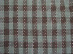 PRICE IS PER HALF METRE100% cotton, made in Japan.Soft teal and brown check with pale pink texture woven over the pattern. Medium weight. Lovely for skirts, dresses, cushions and light home dec.110cm wide