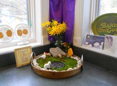 Another way to bring nature tables into small spaces: use a small container or plate. Makes it easy to move around too.