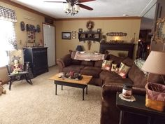 Rachel's double wide is a beautiful example of manufactured home decorating at its finest. Her country primitive decor throughout the home is gorgeous! How to get it done? Ask DIY home decorideas ** More details can be found by clicking on the image. Primitive Homes, Primitive Living Room, Country Primitive, Primitive Decor, Primitive Antiques, Primitive Country Decorating, Primitive Shelves, Primitive Christmas, Country Christmas
