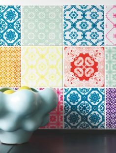 Colourful tiles from arTTiles (quiet expensive) - could also be done with wall stickers, I guess.