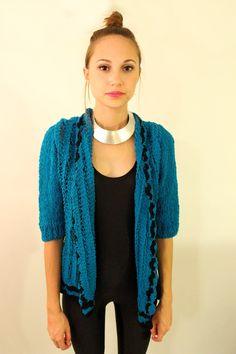 BLUE LAGOON 70s Bright Blue and Black Crotchet Sweater Top. $24.00, via Etsy.