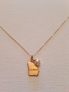 Georgia State Charm Necklace, I WANT THIS!! I plan to move from georgia when I get older and get married somday and I would love to have this for my home state. and its just cute and pretty