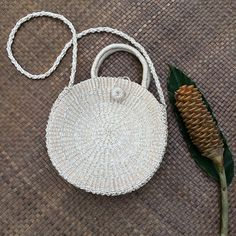 Alyx Abaca Round Bag White made in the Philippines using premium materials. The Lotus Bag is a trendy bag fit for boho-loving fashionistas. Round Bag, Basket Bag, Cheap Bags, Trendy Accessories, Weaving Techniques, Lotus, Straw Bag, Artisan, Pure Products