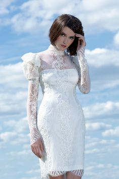 This Chantilly lace dress with long sleeves can be a great option for a civil wedding.