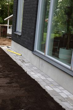 Tiling next to the foundation.