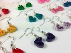 These adorable heart earrings are made using paper quilling techniques and come in multiple color choices...a different shade for each mood! They are super cute and super lightweight. They are also durable and suitable to wear every day. They have been individually hand painted in a sealant which makes them water resistant and UV resistant. Plastic safety backs are included. Can be converted to clip-on earrings! Dimensions: Approx. 1/2in x 1/4in (1in including hook)