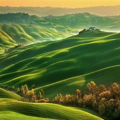 A Spring rising sun over Tuscany, Italy. Photo by @krzysztof_browko