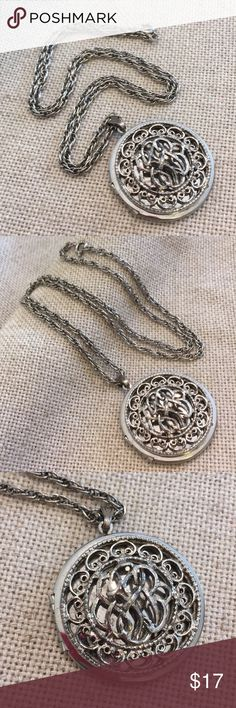 "Vintage Filigree Silvertone Round Locket Pretty piece. Can hold two pictures. Has a universal design that's suppose to look like its monogrammed. Silvertone in color. Very nice condition. No makers mark or brand. Chain 23.75"" inches long. Locket closed is approx 1.5"" in diameter. Vintage Jewelry Necklaces"