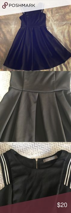 Black Dress Finn and Clover size small polyester black dress with pleats. Worn only a handful of times. In perfect condition. Really flattering dress. Finn & Clover Dresses Mini