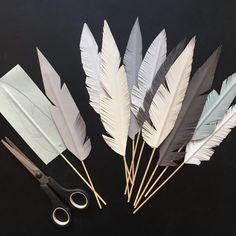 I've seen a lot of people making paper feathers lately. So pretty! I just had to try and make some of my own to boost up the easter spirit in the studio. It was super easy and fun! And they are animal Paper Crafts Origami, Diy Paper, Paper Art, Feather Crafts, Feather Art, Crafts With Feathers, Home Crafts, Diy And Crafts, Arts And Crafts