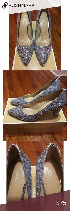 Michael Kors Silver Glitter Abbi Pump - Size 8 Gorgeous Silver Glitter Pumps! Perfect for all Holiday events!! Practically Brand New.  These shoes have only been worn for two hours indoors.  Size 8. Box Included Michael Kors Shoes Heels