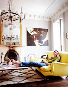 13 Celebs Who Know How to Use Color // Jenna Lyons, yellow sofa, Beni Ourain, fireplace, gold mirror