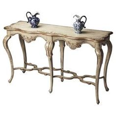 """Handcrafted console table with cabriole legs and a scalloped apron.  Product: Console tableConstruction Material: Poplar solids and MDFColor: CreamFeatures: Carved apronDimensions: 35"""" H x 60"""" W x 18"""" D"""