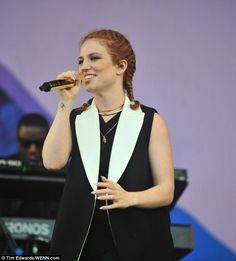 No place she'd rather be! Jess Glynne wore her red locks in a cute braided style as she da...
