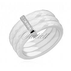 Potrójny pierścionek ceramiczny biały ze srebrnym (pr. 925) elementem - prostokąt z cyrkoniami Pierścionek ceramiczny trzy białe obrączki  waga srebra ~ do 5g łączna szerokość pierścionków - 9mm wymiary srebrnego elementu - 12mm x 2mm Element srebrny wykonany w technologii microsetting