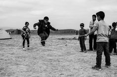 A boy jumping over a rope in Idomeni.  #refugee #jumprope #idomeni #refugee