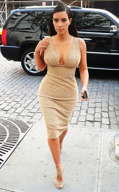 Woah, mama! Kim Kardashian rocks a super sexy, cleavage-baring dress during an outing in NYC.