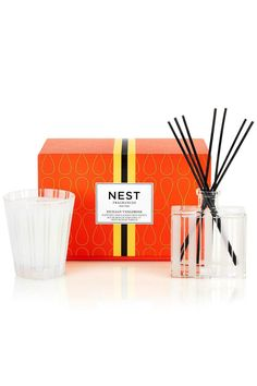 Sicilian tangerine and bergamot are entwined with exotic mango and passionfruit. A duo of two of our signature products specially priced for even more value makes the perfect gift for friends hosts loved ones or yourself. An $88 value.  Reed Diffusor Does Not contain Alchohol Siciliantangerine Candlediffusor Giftset by Nest Fragrances. Home & Gifts - Gifts & Things Rhode Island