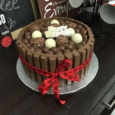 Chocolate Overload Cake I made for a friend's birthday. Chocolate cake with kitkat on the sides. Malteesers, Lindt and Ferrero Rocher chocolates on top.