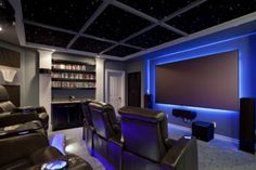 South Austin Home Theater by Zuri Custom Homes & Renovations - Awesome Glow Effect Theater and Seating.I wish dude. Theater Room Decor, Home Theater Setup, Best Home Theater, At Home Movie Theater, Home Theater Design, Home Theater Seating, Home Cinema Room, Home Theater Rooms, Home Entertainment