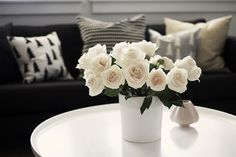 simple seating area - white roses are so calming